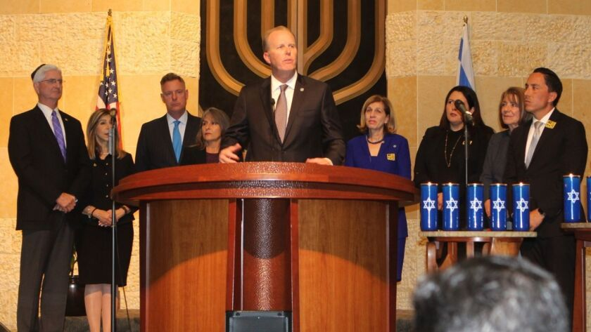 San Diego mayor Kevin Faulconer— flanked by City and County dignitaries — addresses an audience of 2,000 grieving members and supporters of the San Diego Jewish community.