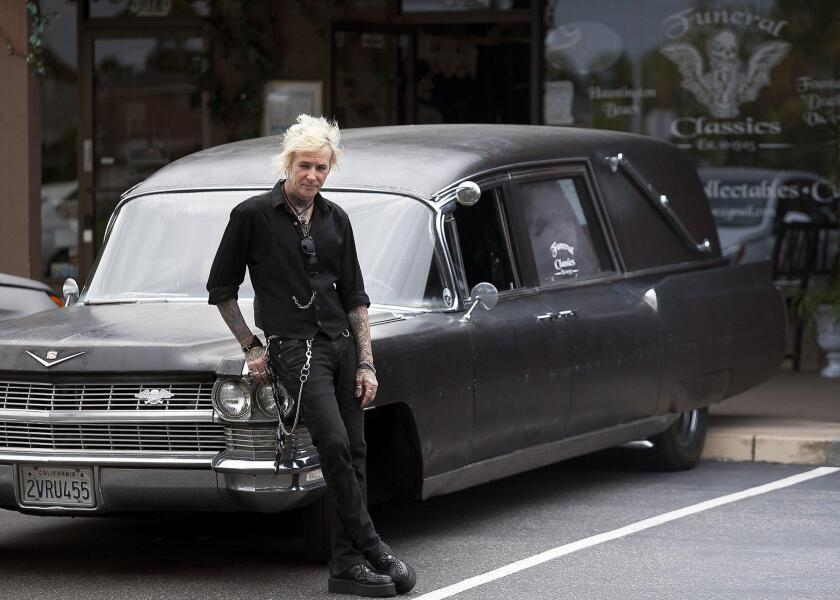 Robert Thorn with his Cadillac hearse