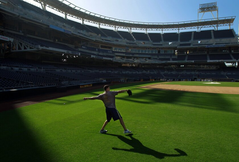 Padres outfielder Will Venable throws during a work out at Petco Park on Thursday, Jan. 19, 2012.