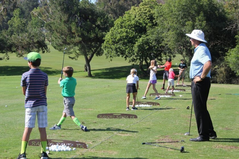 Scott Johnson oversees his young golfers at RSF Golf Club summer camp. Photo by Karen Billing