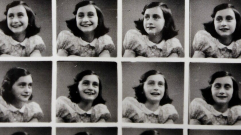 Part of a page of passport-sized photos taken of Anne Frank at a department store before she went into hiding in Amsterdam in 1942, displayed at the Museum of Tolerance in 2013.