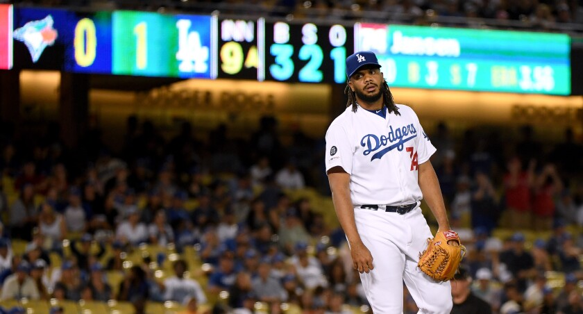 Dodgers' Kenley Jansen reacts after giving up  a solo homerun to Toronto Blue Jays' Rowdy Tellez to tie the game 1-1, during the ninth inning at Dodger Stadium on Wednesday.