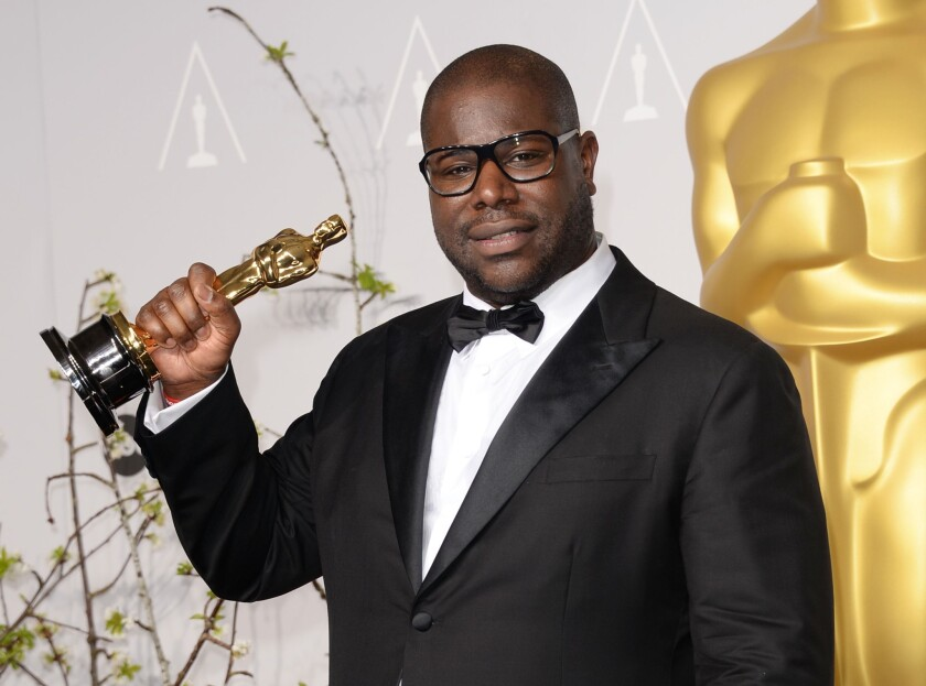 """Director and producer Steve McQueen, winner of Best Picture for """"12 Years a Slave,"""" poses in the press room during the Oscars."""