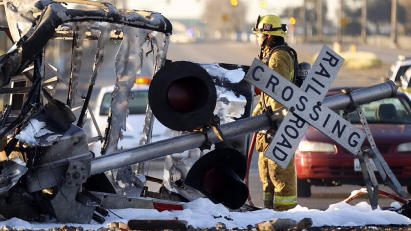 A firefighter stands at the scene of a deadly 2015 Metrolink Crash