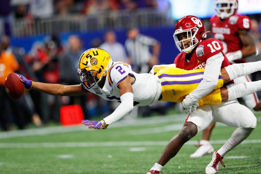 LSU wide receiver Justin Jefferson scores a touchdown against the Oklahoma Sooners in the Peach Bowl on Dec. 28.