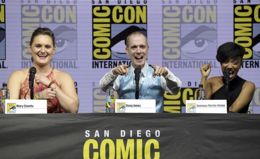 """Mary Chieffo, from left, Doug Jones and Sonequa Martin-Green react to the crowd at the """"Star Trek: Discovery"""" panel on day two of Comic-Con International."""