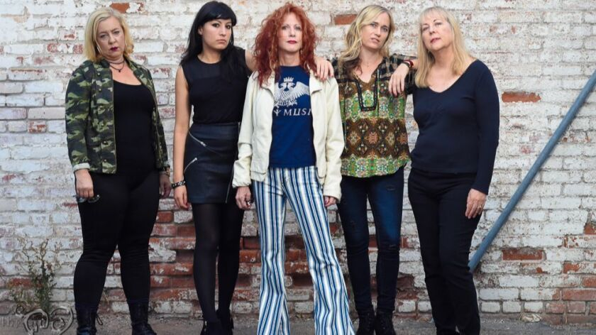 The current members of The Dinettes are, from left: drummer Laurie Chadwick, guitarist Diana Death,