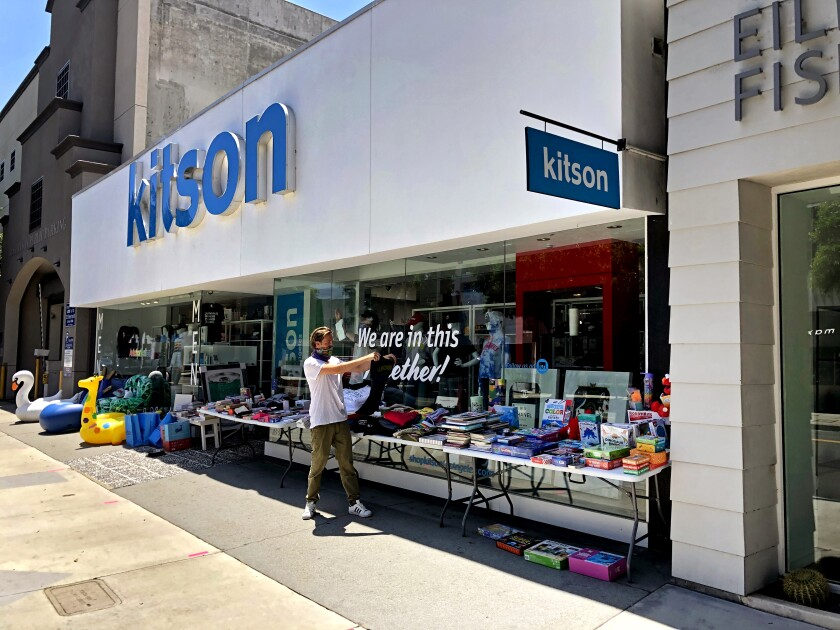 The Kitson store on Robertson with employee Tom Ernst out front