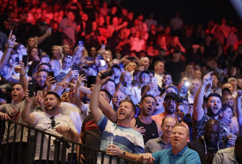 Fans sing during weigh-ins for Deontay Wilder and Tyson Fury ahead of their WBC heavyweight title fight Saturday at the MGM Grand Garden Arena.