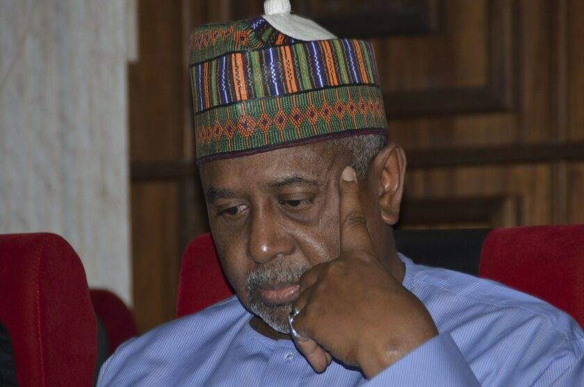FILE- In this Tuesday, Sept.1, 2015 file photo, Nigeria's former national security adviser Sambo Dasuki attends a hearing to face charges of possessing weapons illegally, at the Federal High Court in Abuja, Nigeria. Dasuki is accused of diverting $2.1 billion meant to fight the Boko Haram Islamic i