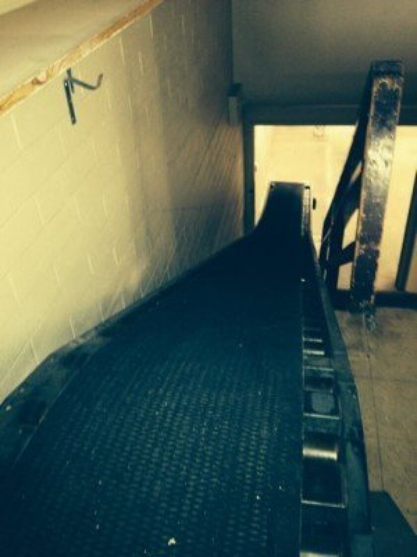 This conveyor belt leads to 900-square foot basement that will be available to a first-floor retail tenant.