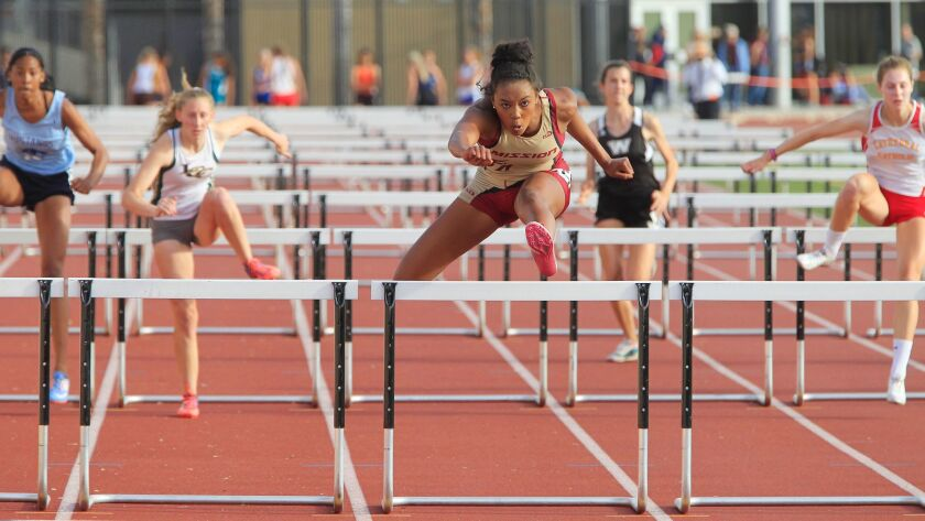 Mission Hills senior Asia Smith wins the 100-meter hurdles at the Escondido Invitational on Friday.
