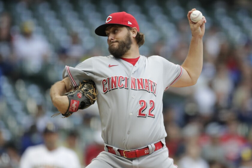 Cincinnati Reds' Wade Miley pitches during the first inning of the team's baseball game against the Milwaukee Brewers on Friday, July 9, 2021, in Milwaukee. (AP Photo/Aaron Gash)