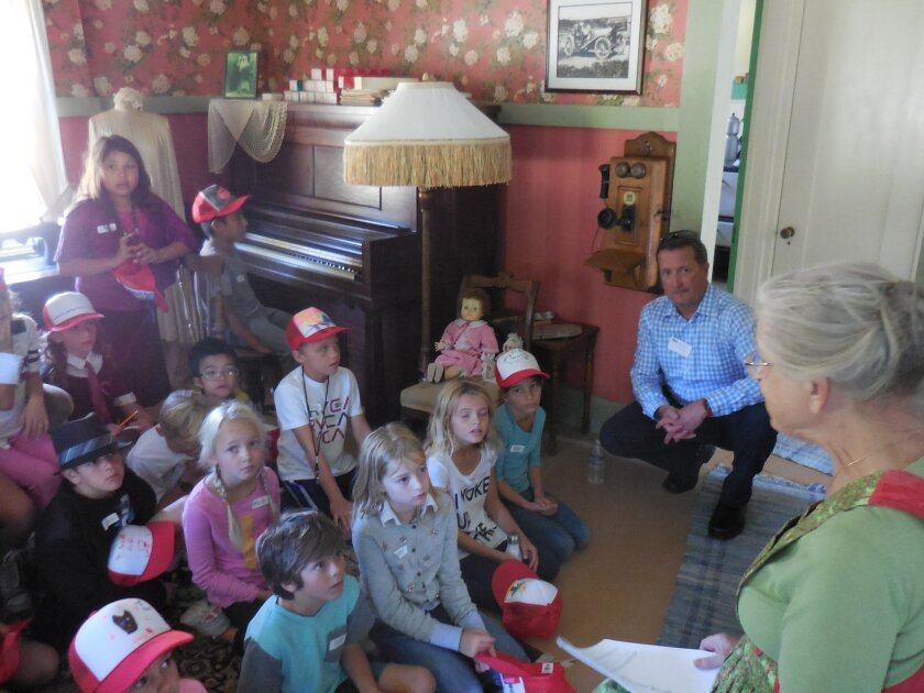 Volunteers teach children about the community's history, starting from when Native Americans inhabited the region.