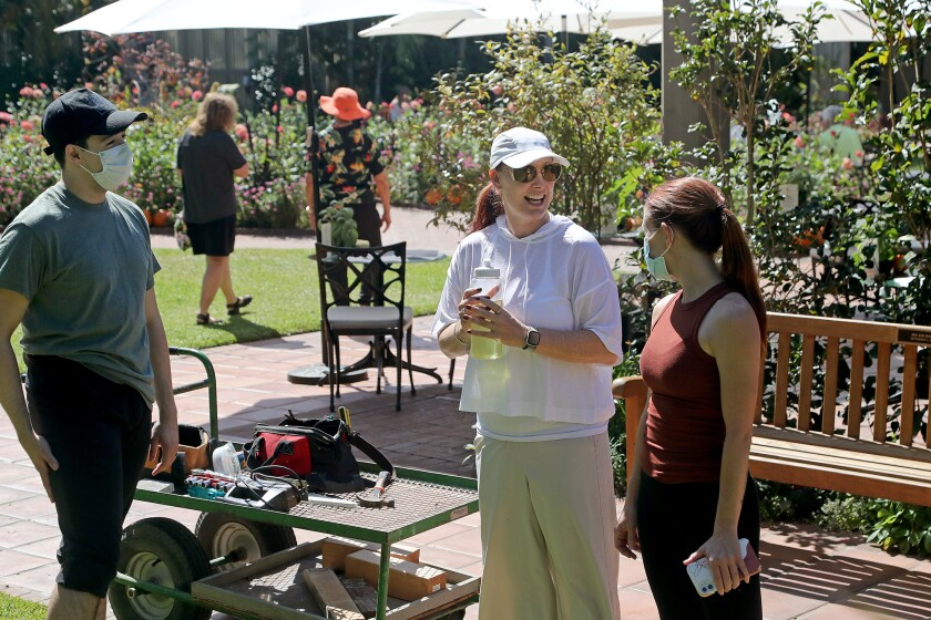 Jennifer Backhaus, center, with Kaitlin Regan, right, and Joao Ducci, at a rehearsal Thursday at Sherman Gardens.