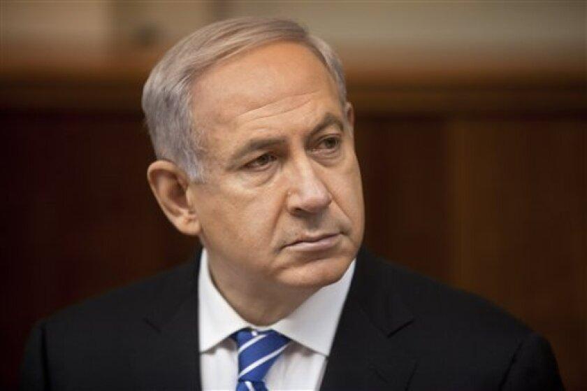 Israeli Prime Minister Benjamin Netanyahu attends the weekly cabinet meeting in his Jerusalem office, Sunday, March 10, 2013. (AP Photo/Sebastian Scheiner, Pool)
