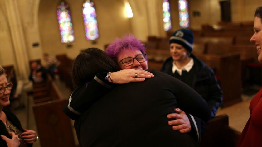 LOS ANGELES, CA-MARCH 3, 2019: Reverend Denyse Barnes, who identifies as a lesbian, gives a hug to A