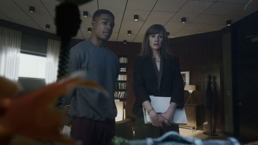 """Stephan James plays a returning veteran and Julia Roberts his counselor in a scene from the new Amazon Prime series """"Homecoming."""""""