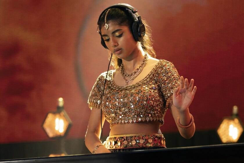 "Avantika Vandanapu wears headphones as she DJs in ""Spin"" on Disney."