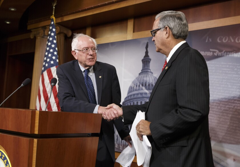 Congressional negotiators Sen. Bernie Sanders (I-Vt.), left, and Rep. Jeff Miller (R-Fla.) shake hands as they outline their agreement on a compromise to fix the vast healthcare system responsible for treating the nation's veterans.