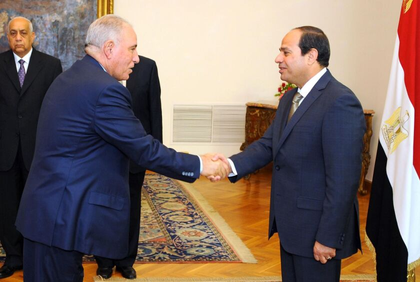 Egyptian President Abdel Fattah al-Sisi, right, shakes hands with Egypt's Justice Minister Ahmed al-Zind during his swearing-in ceremony in Cairo on May 20, 2015.