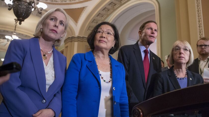 Democratic Sens. Kirsten Gillibrand, from left, Mazie Hirono, Richard Blumenthal and Patty Murray speak with reporters about Supreme Court nominee Brett Kavanaugh on Tuesday.