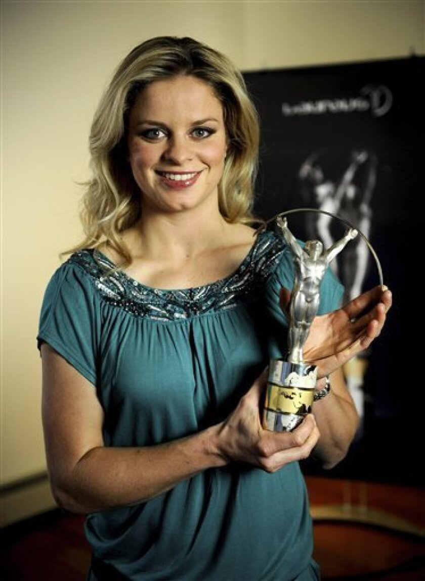 """In this image released by the Laureus Awards on Wednesday March 10, 2010, Belgian tennis player Kim Clijsters poses with her award for """" Laureus World Comeback of the Year"""". Clijsters was unable to attend the awards ceremony in Abu Dhabi, UAE, on Wednesday. (AP Photo/Jeffrey Zelevansky/Getty Images"""