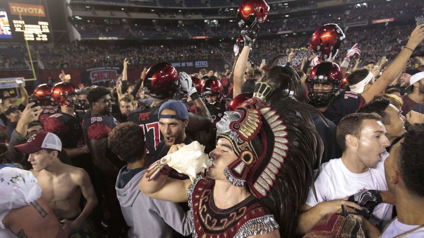 The Aztecs' mascot sounds the couch shell as fans and players celebrate the Aztecs' 20-17 win over Stanford at SDCCU Stadium earlier this month.