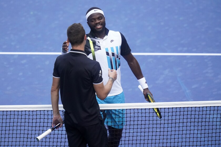 Frances Tiafoe, right, of the United States, reacts after winning a match against Marton Fucsovics, of Hungary, during the third round of the US Open tennis championships, Saturday, Sept. 5, 2020, in New York. (AP Photo/Frank Franklin II)