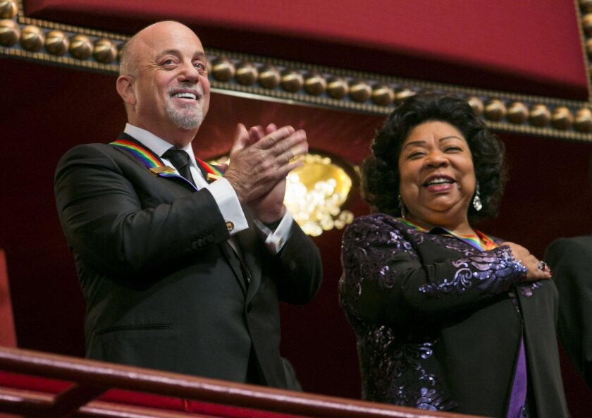 Kennedy Center honorees Billy Joel, left, and opera singer Martina Arroyo, right, attend the 2013 Kennedy Center Honors at the Kennedy Center on Sunday in Washington, D.C.