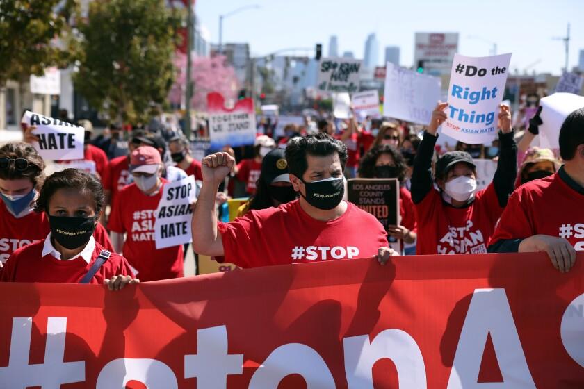 U.S. Representative Jimmy Gomez, center, marches in solidarity