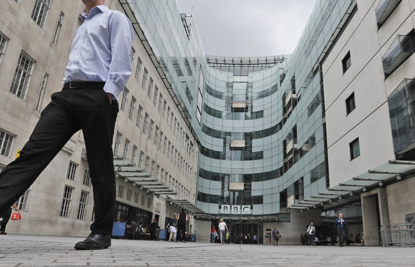 FILE - This Wednesday, July 19, 2017 file photo shows the main entrance to the headquarters of the publicly funded BBC in London. British radio host Sideman quit the BBC on Saturday Aug. 8, 2020, over the corporation's decision to include a racial slur in a news report about a racist attack. (AP Photo/Frank Augstein, File)
