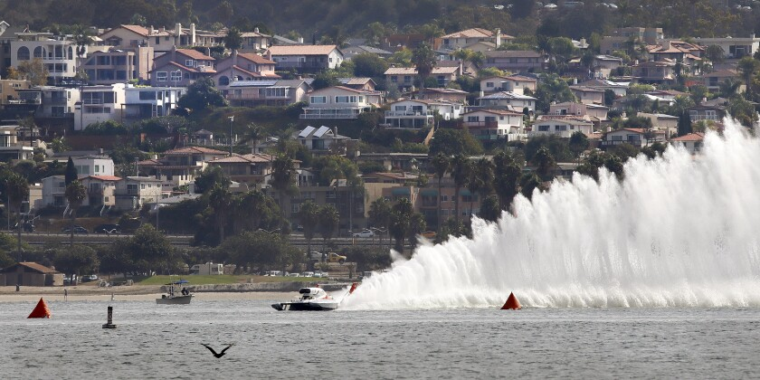 Unlimited hydroplane Miss Tri-Cities practices on the course at Mission Bay with Bay Park in the background.