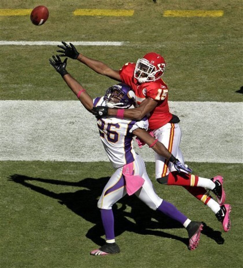 Minnesota Vikings cornerback Antoine Winfield (26) breaks up a pass intended for Kansas City Chiefs wide receiver Steve Breaston (15) during the second half of an NFL football game Sunday, Oct. 2, 2011 in Kansas City, Mo. The Chiefs won the game 22-17. (AP Photo/Charlie Riedel)