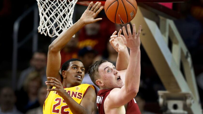 USC guard De'Anthony Melton, left, battles Washington State forward Josh Hawkinson for a rebound in a Pac-12 basketball game at the Galen Center on March 1.