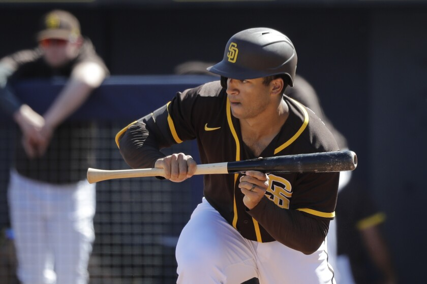 Padres' Trent Grisham bunts against the Dodgers during a spring training game March 9, 2020, in Peoria, Ariz.