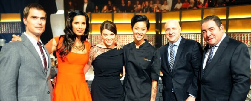 From left, Hugh Acheson, Padma Lakshmi, Gail Simmons, winner Kristen Kish, Tom Colicchio and Emeril Lagasse.