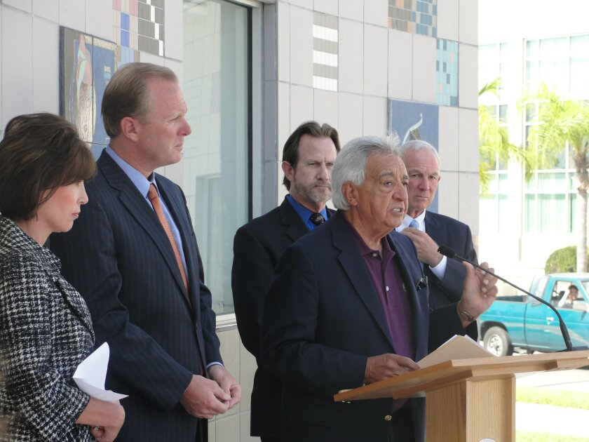 Local officials criticize the state's redevelopment shift at a press conference in July. From left, Kris Michell, Downtown San Diego Partnership; San Diego City Councilman Kevin Faulconer; National City Mayor Ron Morrison; La Mesa Mayor Art Madrid (at the podium), and San Diego Mayor Jerry Sanders.