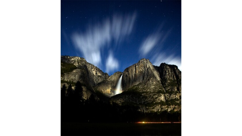 The movement of the clouds at 10 p.m. and slight rainbow can be seen at the base of Upper Yosemite Fall during a 30-second exposure.
