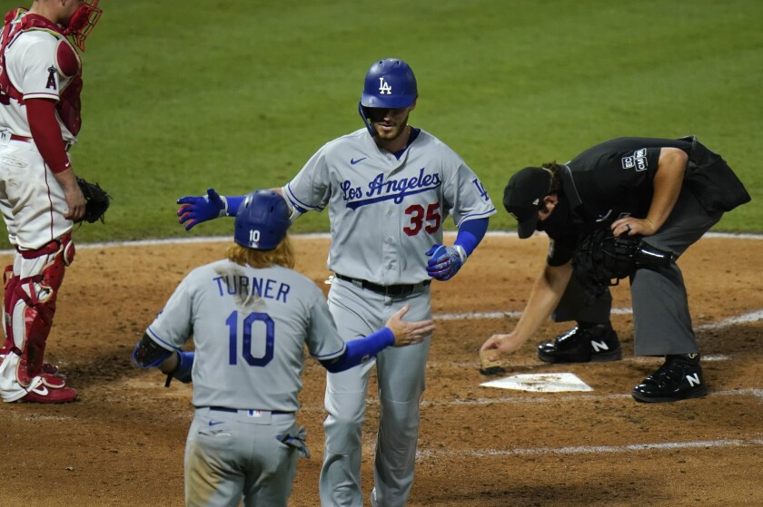 The Dodgers' Cody Bellinger celebrates with teammate Justin Turner after hitting a two-run home run.