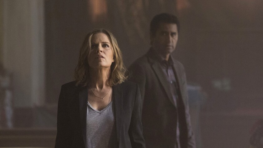 """Kim Dickens and Cliff Curtis in """"Fear the Walking Dead"""" on AMC."""