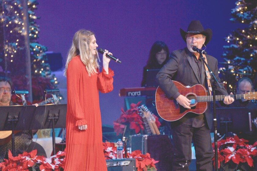 Anna Vaus and her father, Grammy Award-winning Poway Mayor Steve Vaus, perform at the 2018 Carols by Candlelight concert. They will perform Friday and Saturday as part of this year's Candlelight edition.