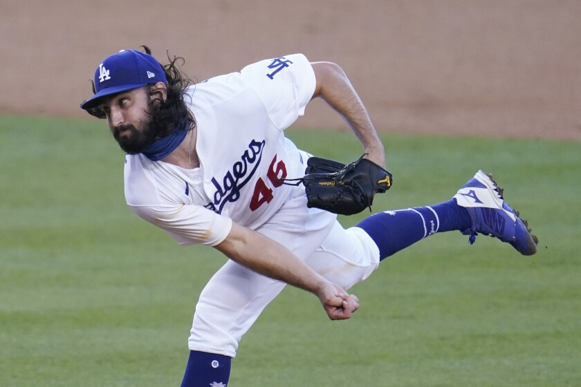 Los Angeles Dodgers starter Tony Gonsolin throws to the San Diego Padres during the first inning of a baseball game Wednesday, Aug. 12, 2020, in Los Angeles. (AP Photo/Marcio Jose Sanchez)