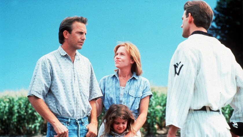"""Kevin Costner, Amy Madigan, Gaby Hoffmann and Dwier Brown in the 1989 movie """"Field of Dreams."""""""