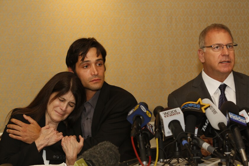 Michael Egan, center, his attorney Jeff Herman, right, and Egan's mother, Bonnie Mound, at a news conference in April.