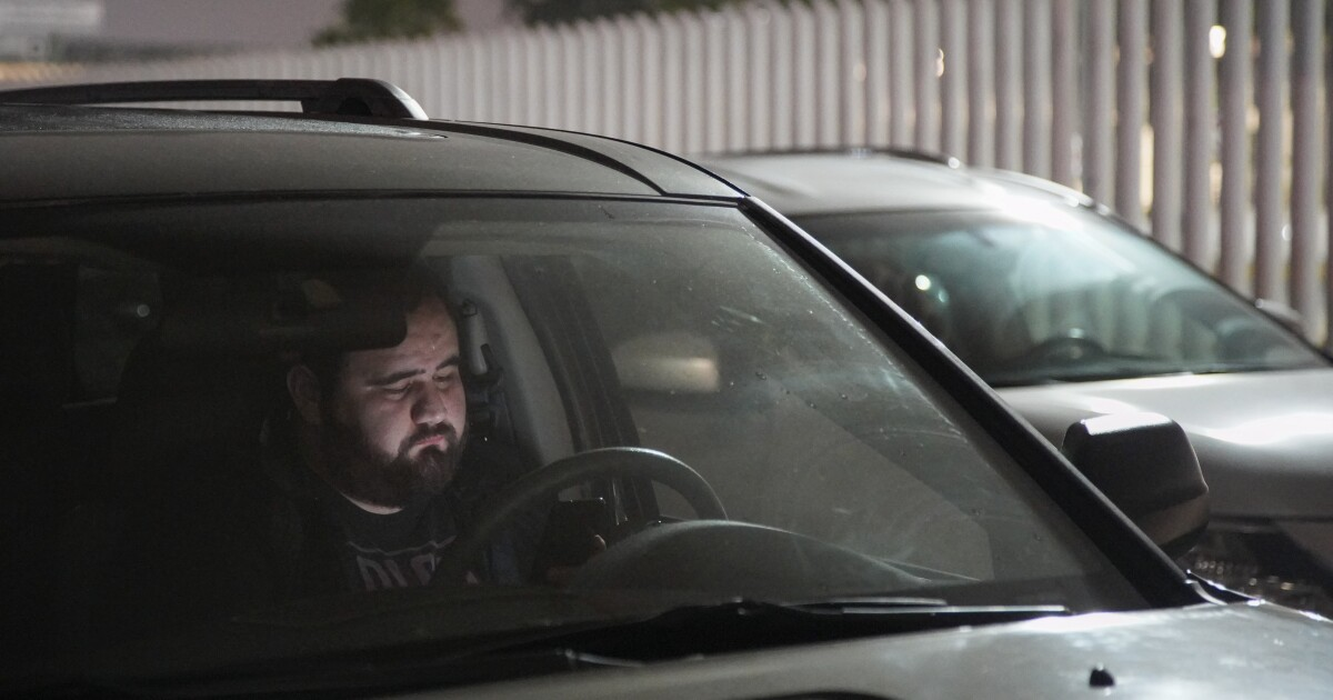 Some cross-border workers are sleeping in their cars to get to work on time