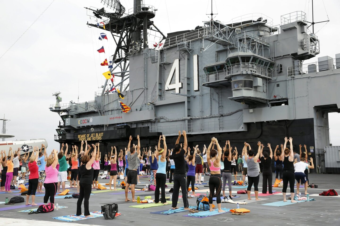 "To kick off a year-long initiative, Scripps Health and the Downtown Partnership sponsored the inaugural ""Stretch Yourself with Scripps"" yoga class on the flight deck of the USS Midway on Saturday."