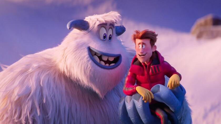 """A Yeti holds a man in his hand in the animated film """"Smallfoot."""""""