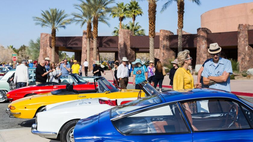 Visitors check out Mid-Century autos at last year's Vintage Car Show in Palm Springs. This year's sh
