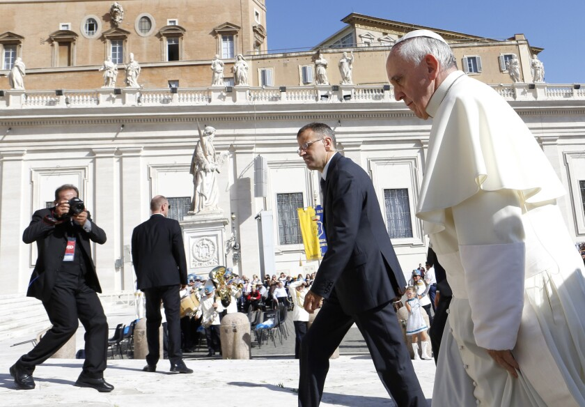 Pope Francis arrives for his weekly general audience in St. Peter's Square at the Vatican.